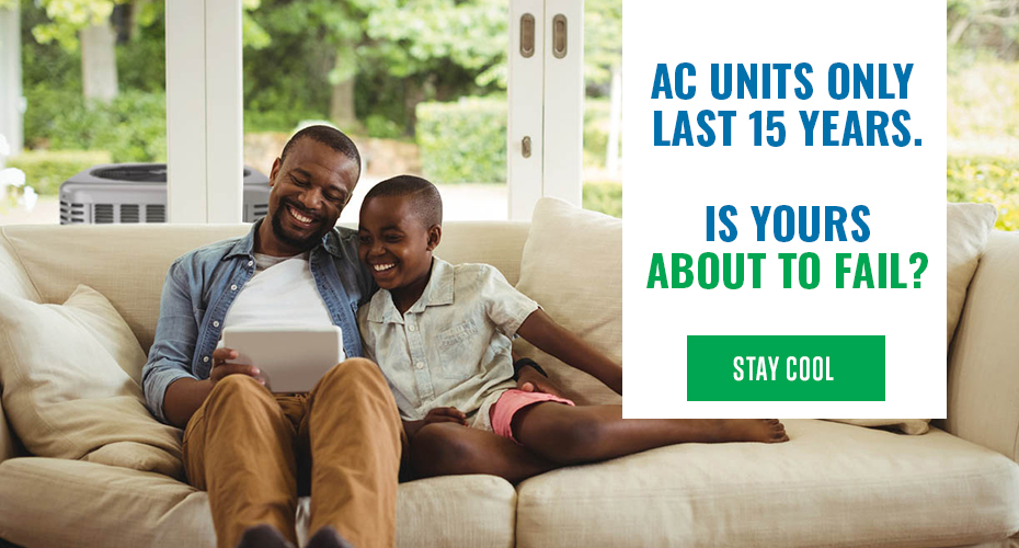 father and son sitting on couch with graphic to the side advertising ac units